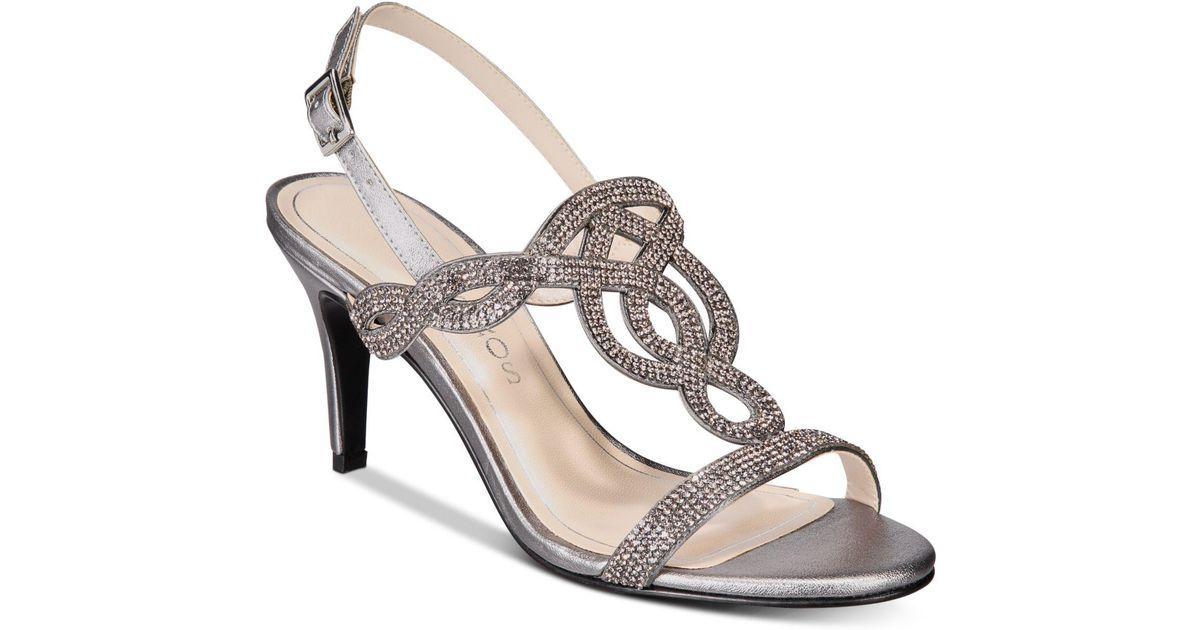 dc1d57c78266 Lyst - Caparros Pharrell Embellished Evening Sandals in Metallic