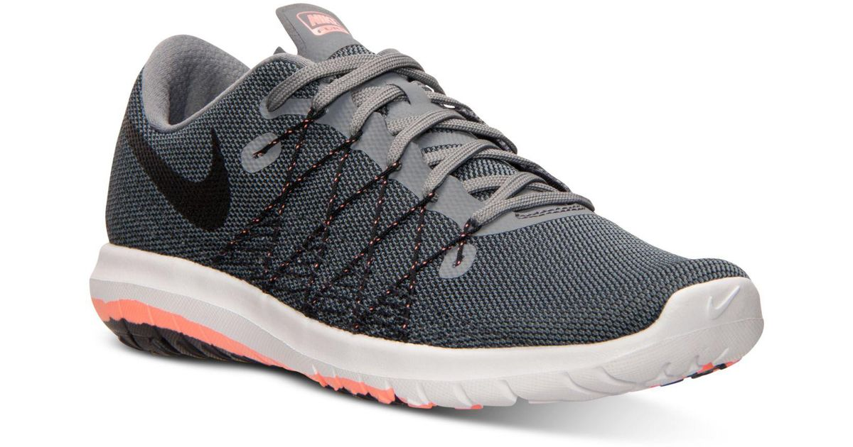 223fb4b86aba ... dark grey white persian violet d3f3f 17974  sweden lyst nike womens flex  fury 2 running sneakers from finish line in gray 5ffe6 aa2ae