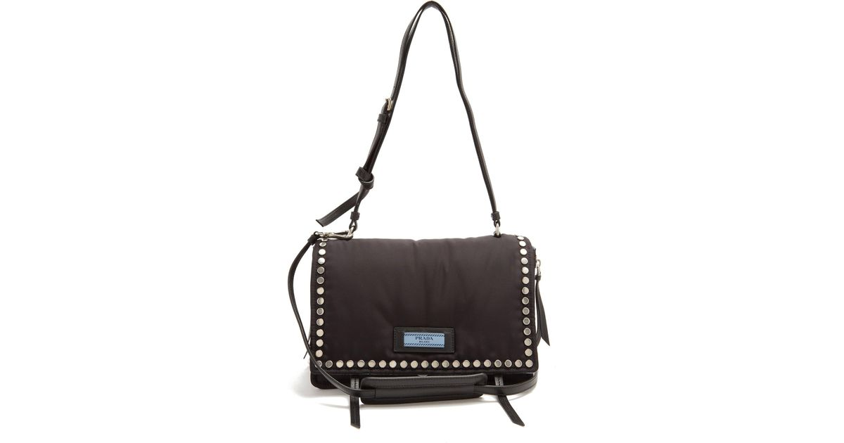 5af2da8d9044 Lyst - Prada Stud-embellished Nylon Cross-body Bag in Black