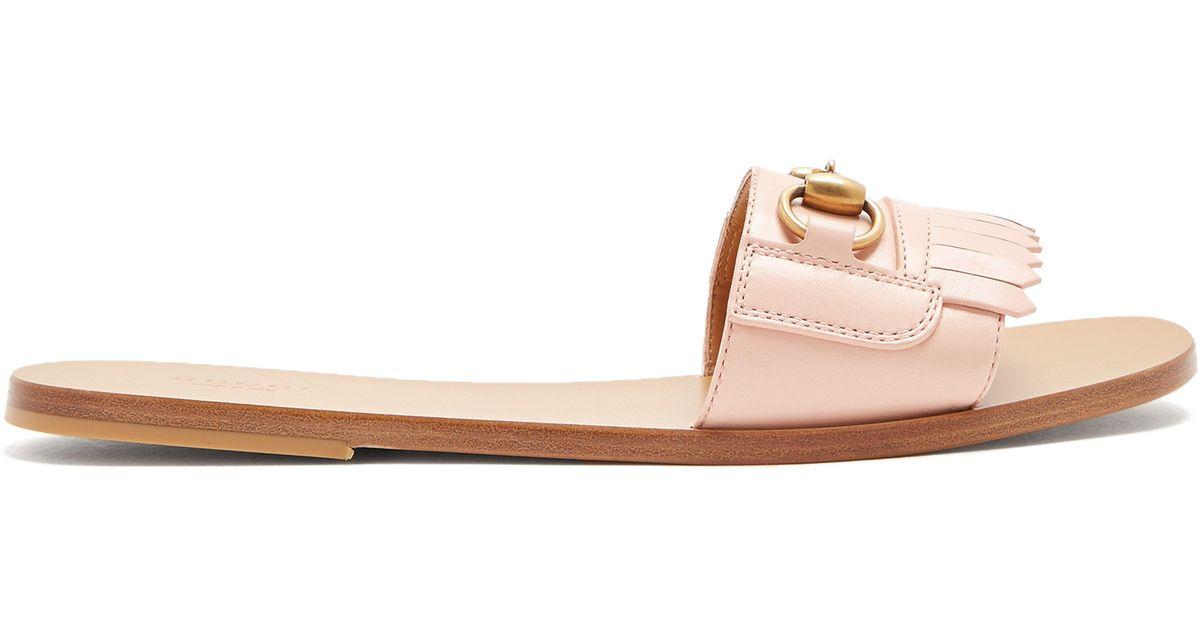 e11a4d17ca9 Gucci Leather Fringe Horsebit Slide Sandal in Pink - Lyst