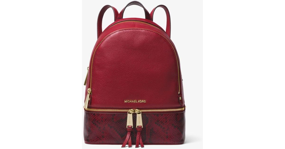167156dfae Lyst - Michael Kors Rhea Medium Pebbled And Snake-embossed Leather Backpack  in Red