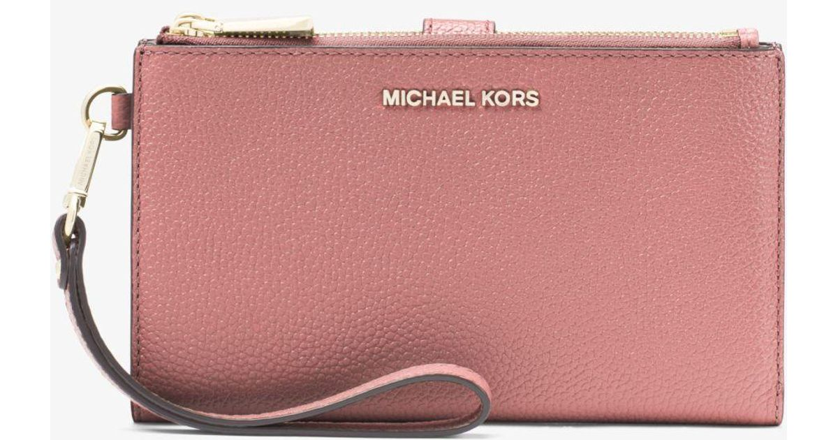 06728dced62841 Michael Kors Adele Pebbled Leather Smartphone Wallet in Pink - Lyst
