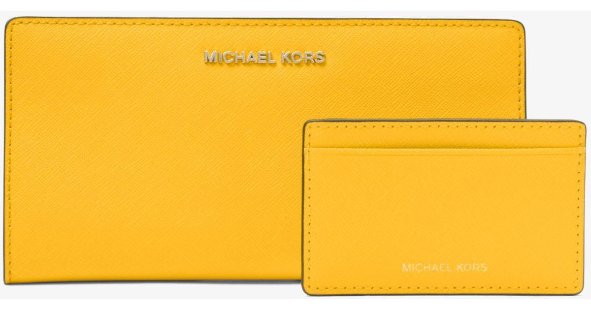 0fba5050c817 Michael Kors Large Saffiano Leather Slim Wallet in Yellow - Lyst