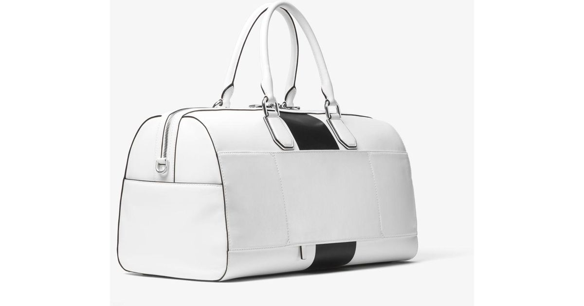 e7a1976cd6 Lyst - Michael Kors Mercer Large Leather Weekender in White