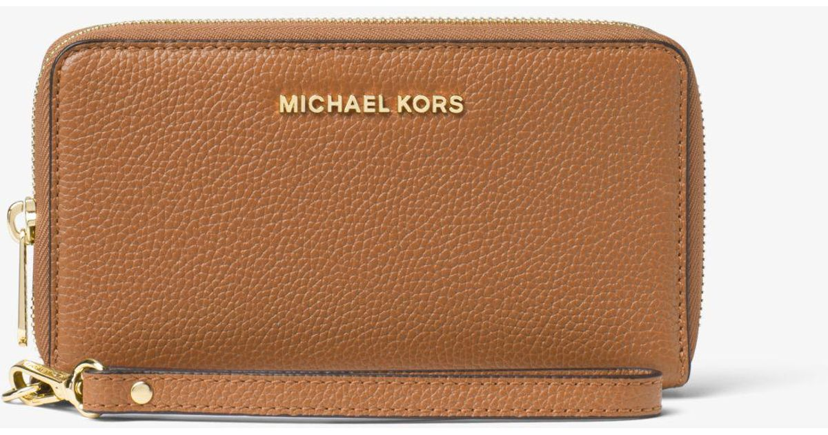 ed6b16ad1ff600 Lyst - Michael Kors Mercer Large Leather Smartphone Wristlet in Brown