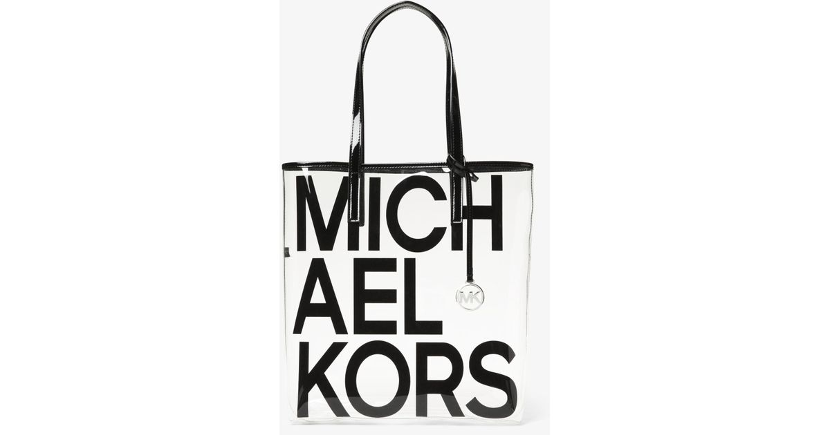 68a31cea7 ... best price lyst michael kors the michael large graphic logo print clear  tote in black 79586