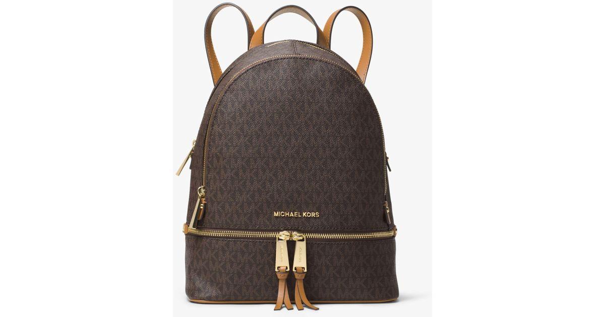 74ae9856a37f ... where to buy lyst michael kors rhea medium backpack in brown d8058 52872