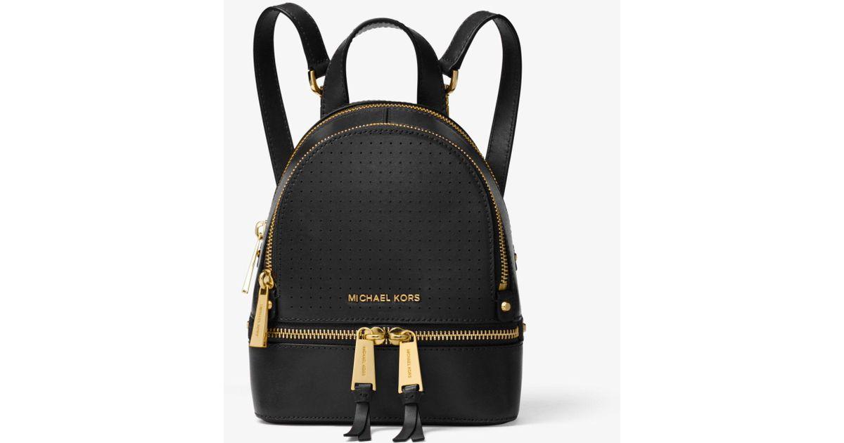 332388b611fb Lyst - Michael Kors Rhea Mini Perforated Leather Backpack in Black