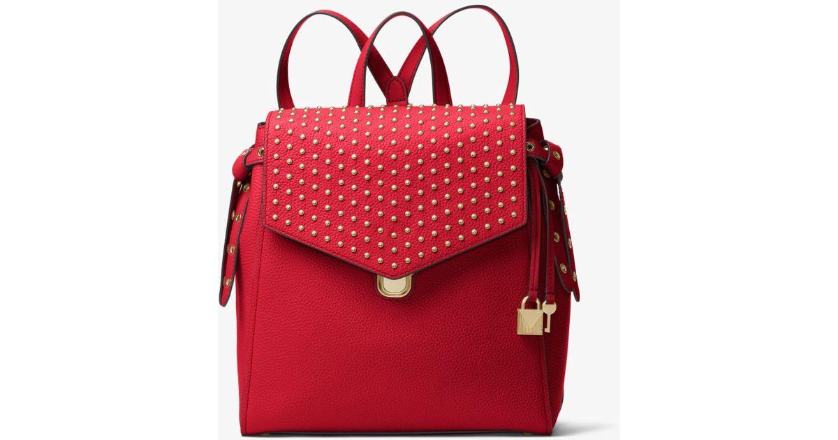 bdf526d95c943 Lyst - Michael Kors Bristol Medium Studded Leather Backpack in Red