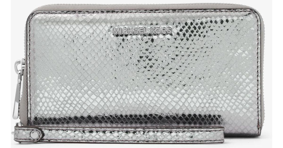 d91ecdd9592e Michael Kors Jet Set Metallic Embossed Leather Smartphone Wristlet in  Metallic - Lyst