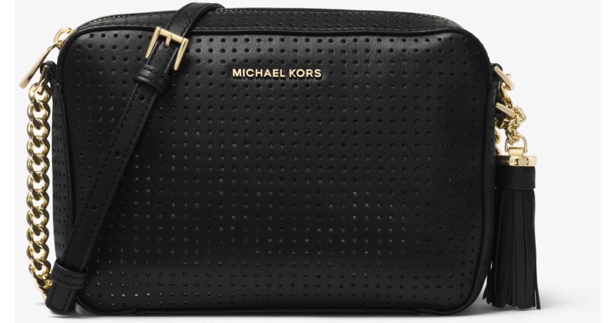 d458a3a06e92 Michael Kors Ginny Medium Perforated Leather Crossbody Bag in Black - Lyst
