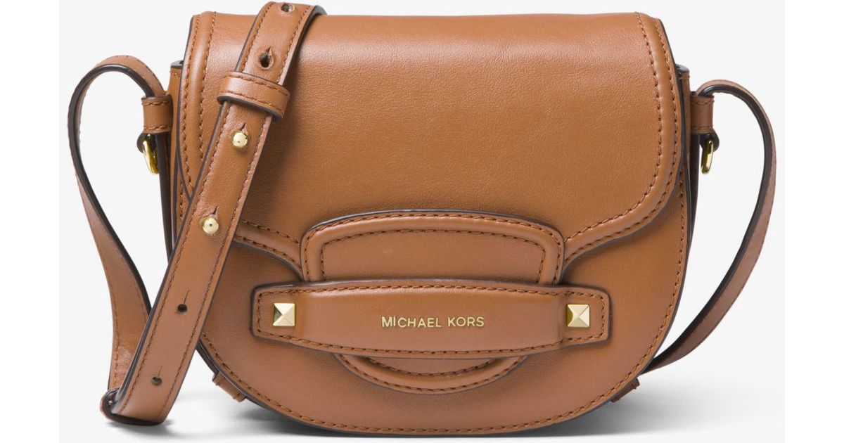 dc370d1477e8e Lyst - Michael Kors Cary Small Leather Saddle Bag in Brown