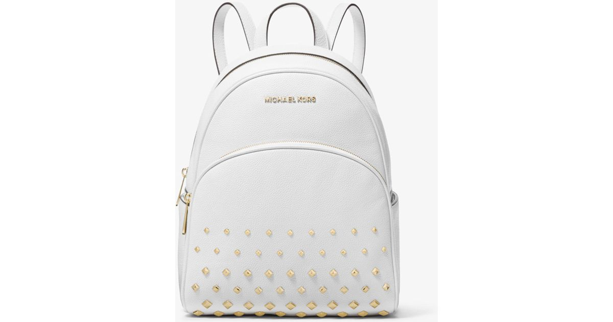 2ffd54308b5eda Michael Kors Abbey Medium Studded Pebbled Leather Backpack in White - Lyst