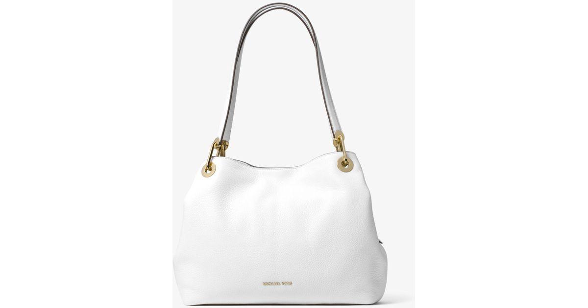 a9fec881e6e37 ... order lyst michael kors raven large leather shoulder bag in white 69794  a080a