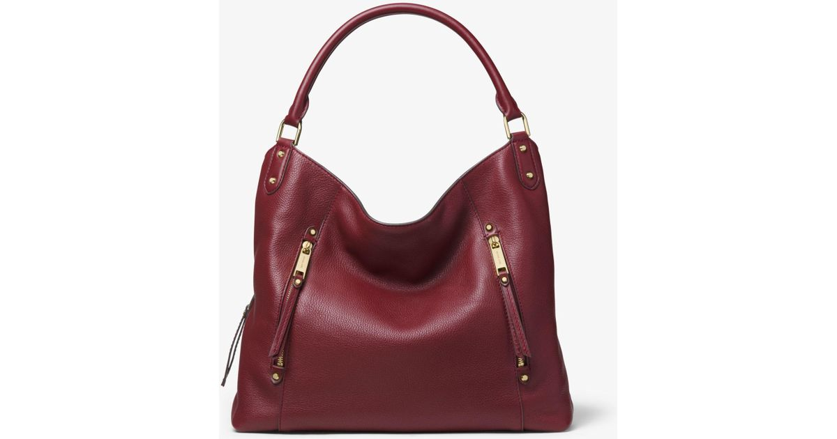 9abf31822a28 Lyst - Michael Kors Evie Large Pebbled Leather Shoulder Bag in Red