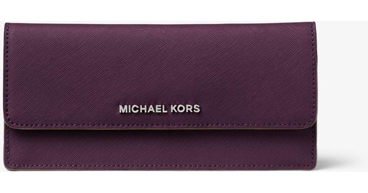 037f7dbd2749d Lyst - Michael Kors Travel Slim Saffiano Leather Wallet in Purple