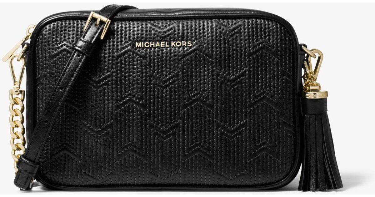 b88d8718bc48 Lyst - MICHAEL Michael Kors Ginny Medium Deco Quilted Leather Crossbody Bag  in Black