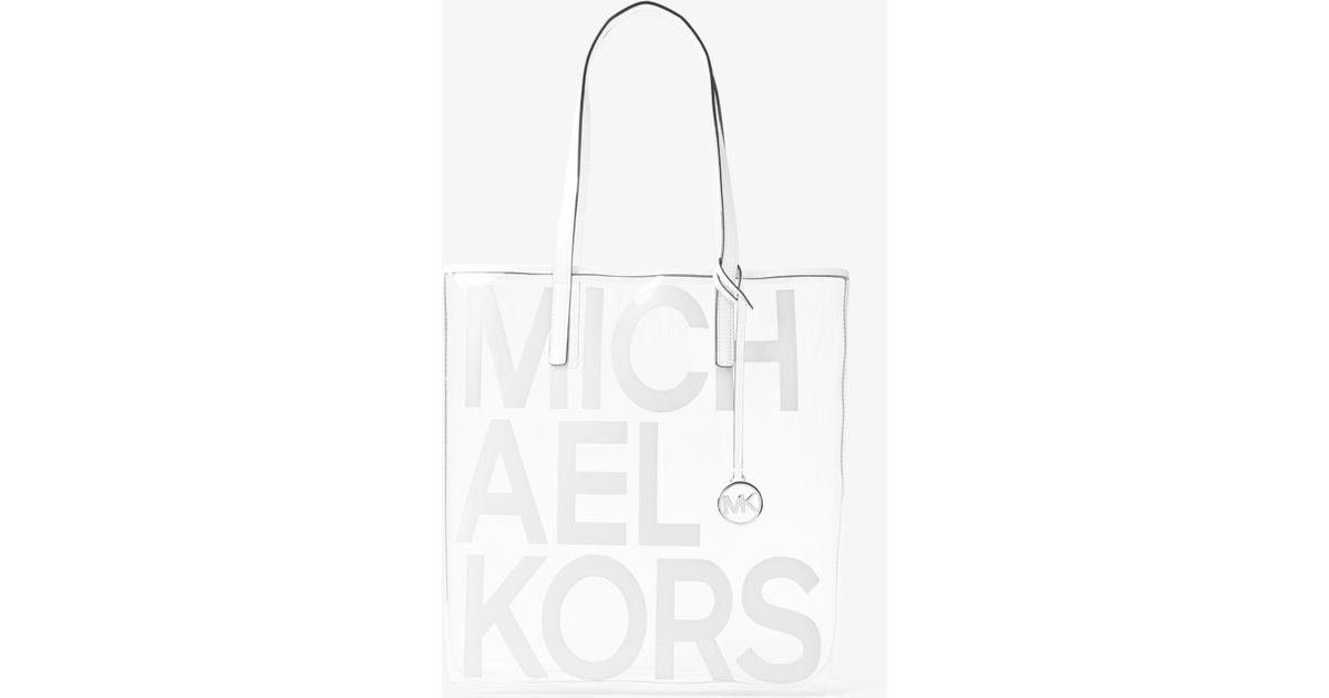8ea544ee2f Michael Kors The Michael Large Graphic Logo Print Clear Tote Bag in White -  Save 7% - Lyst