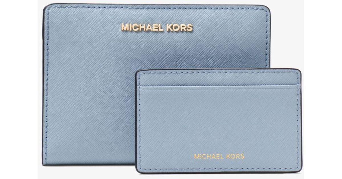 6c0170611da6 Lyst - Michael Kors Medium Saffiano Leather Slim Wallet in Blue