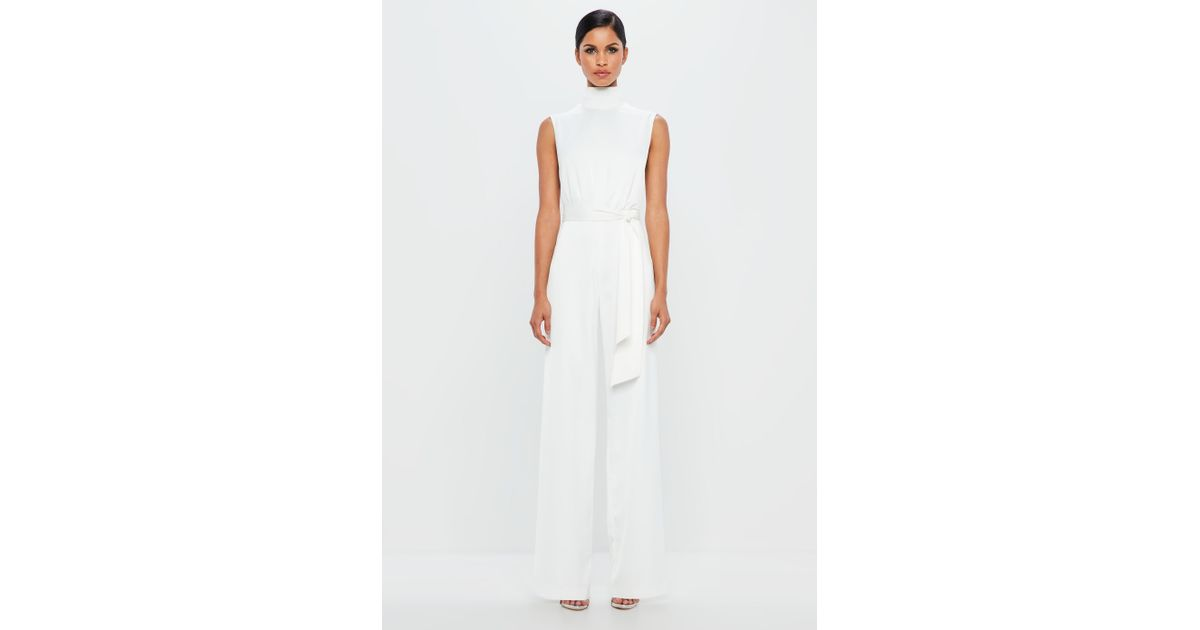 0b7329f09c5 Missguided Peace + Love White Satin High Neck Belted Jumpsuit in White -  Lyst
