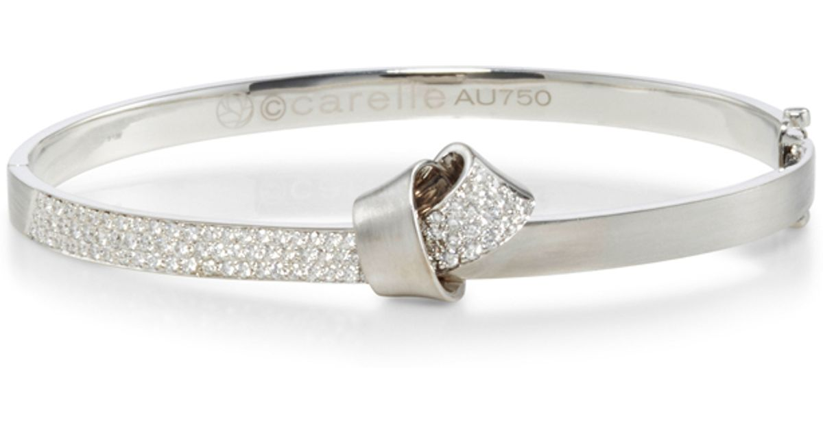 Carelle 18k White Gold Knot Bangle In Metallic Lyst