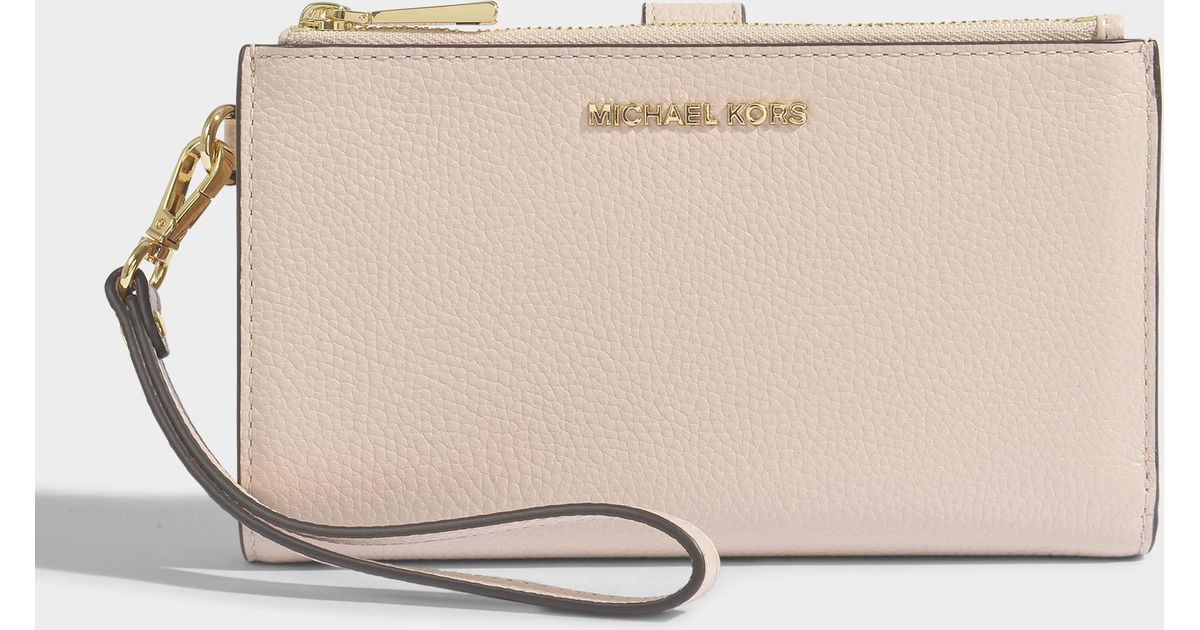d6b86dd0198b MICHAEL Michael Kors Double Zip Wristlet In Soft Pink Mercer Pebble Leather  in Natural - Lyst