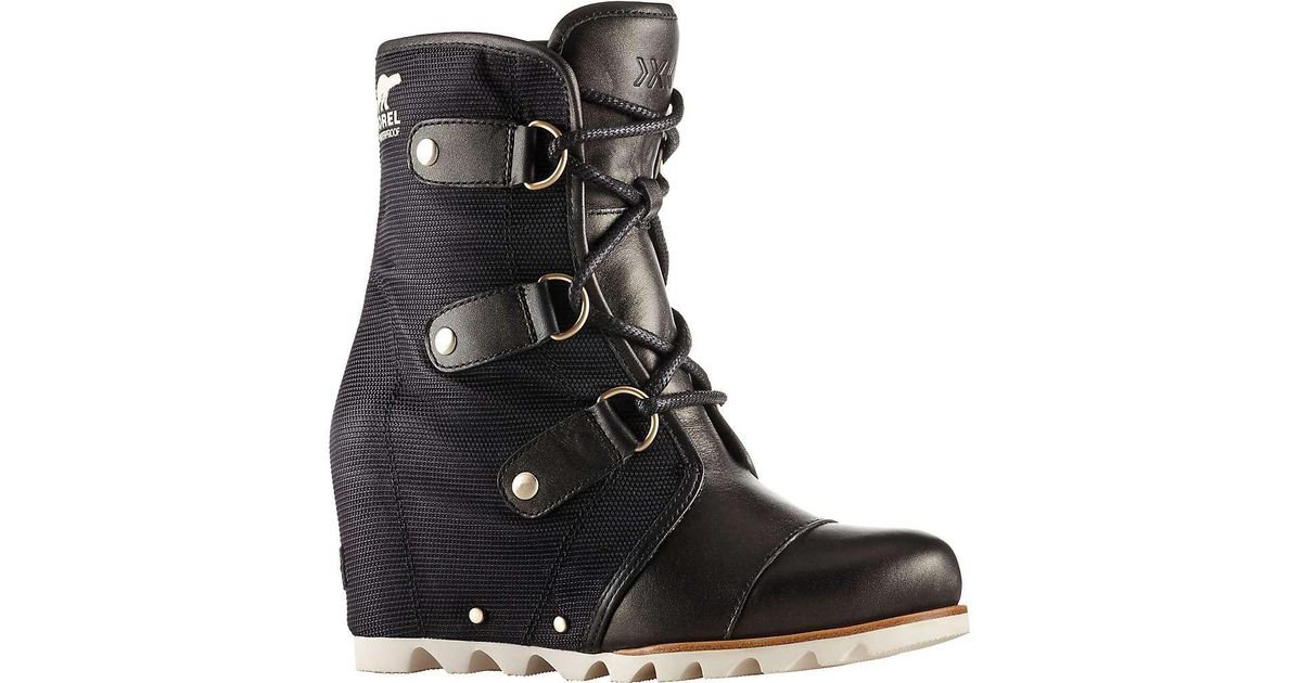 0f53e22ded9 Lyst - Sorel Joan Of Arctic Wedge Mid X Celebration Boot in Black