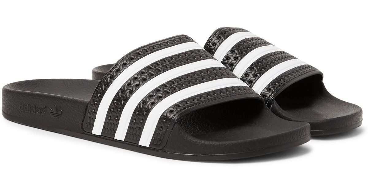 ae7ecdb67dc Lyst - adidas Originals Adilette Textured-rubber Slides in Black for Men