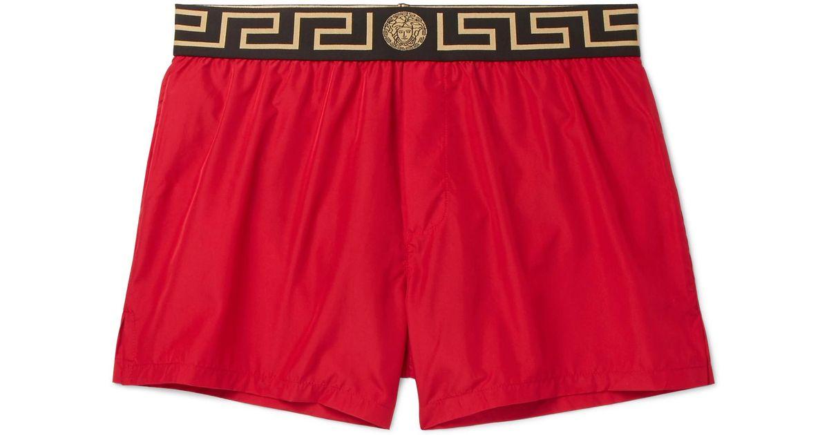 296745b802ec3 Lyst - Versace Slim-fit Short-length Logo-trimmed Swim Shorts in Red for Men