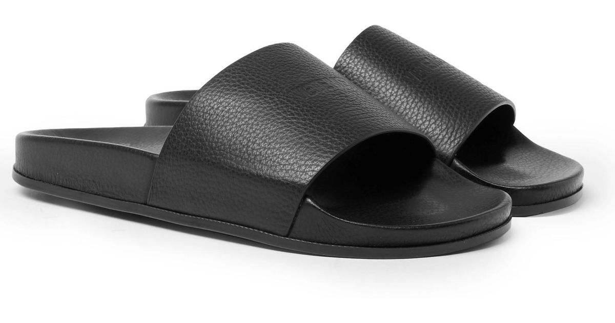 lyst vetements logo embossed full grain leather slides in black