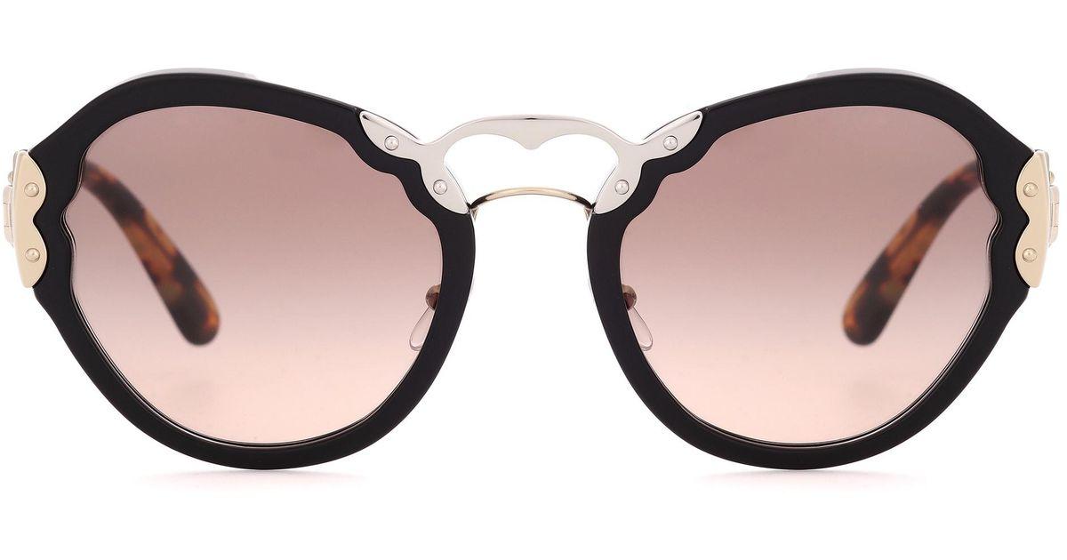 88e84ad86843b Lyst - Prada Wanderer Cat-eye Sunglasses in Black