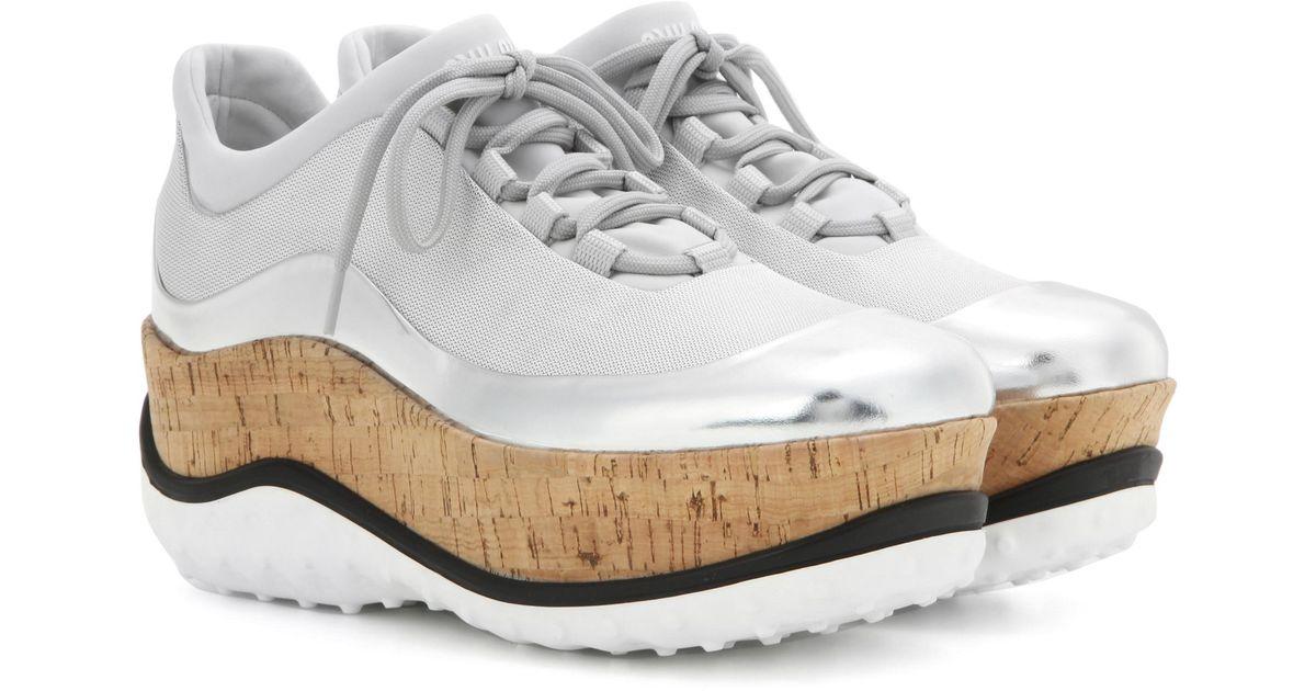 Miu Miu Patent leather-trimmed platform sneakers RmuVCS55l