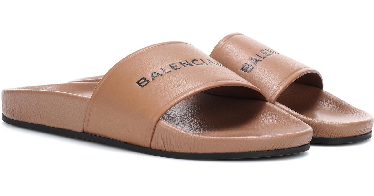 balenciaga leather slides in brown lyst