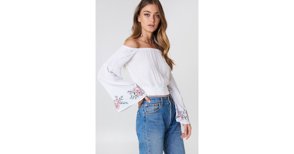 028c8a281d9fc Lyst - NA-KD Embroidered Smocked Off Shoulder Top in White