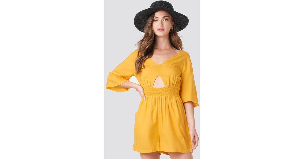 6ddb0ce3363 Lyst - NA-KD Cut Out Detail Playsuit Citrus in Yellow