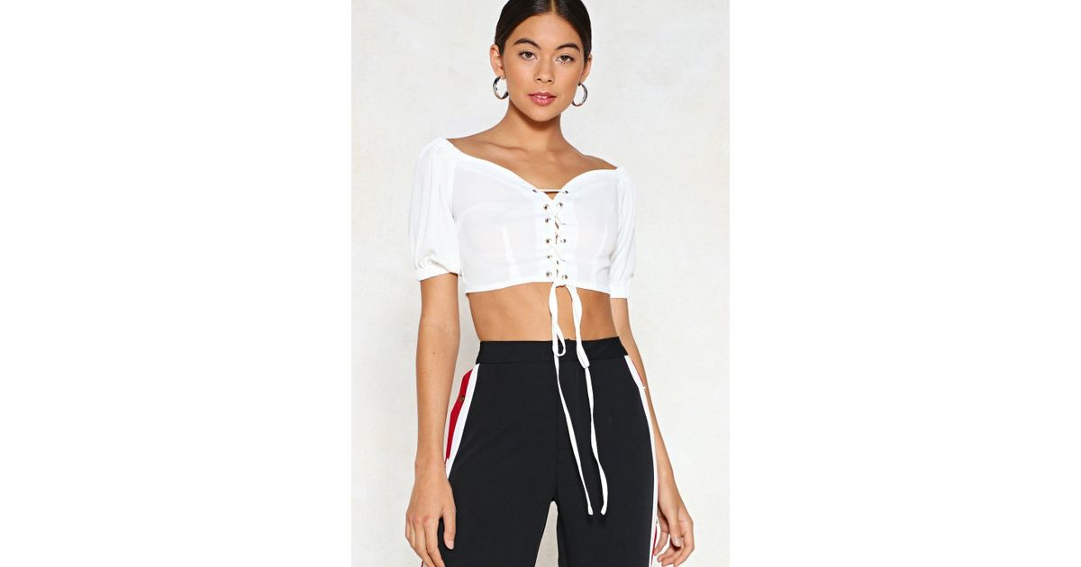 8d1f5affb0bc59 Lyst - Nasty Gal On The Hunt Lace-up Top in White