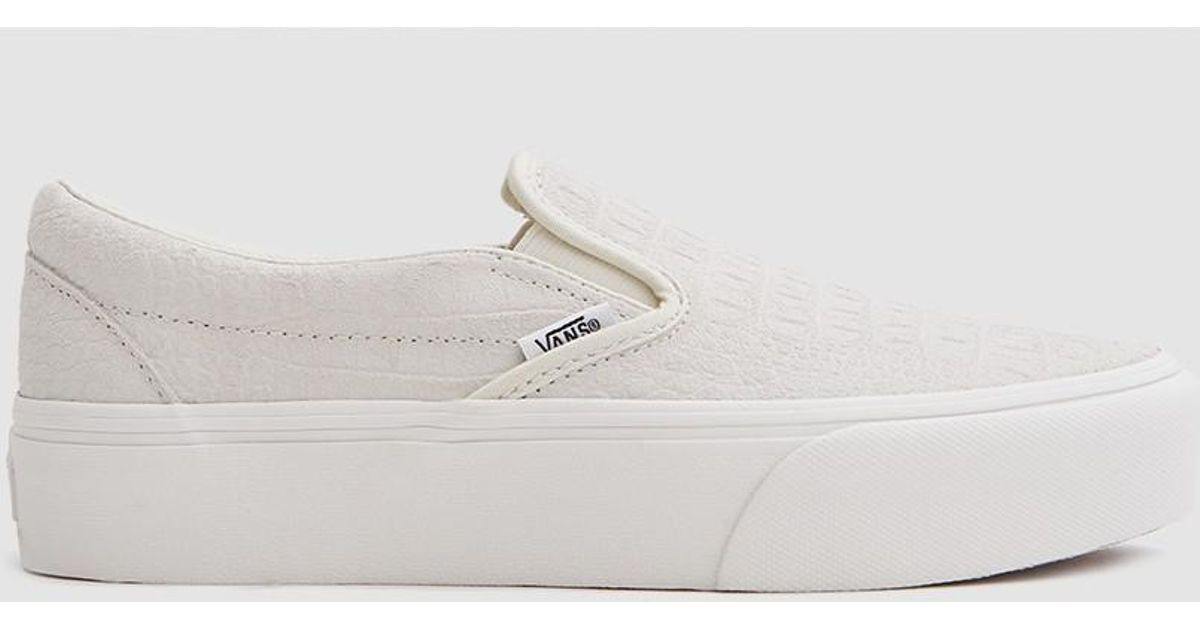 68b1778a49e Lyst - Vans Classic Embossed Platform Slip On in White