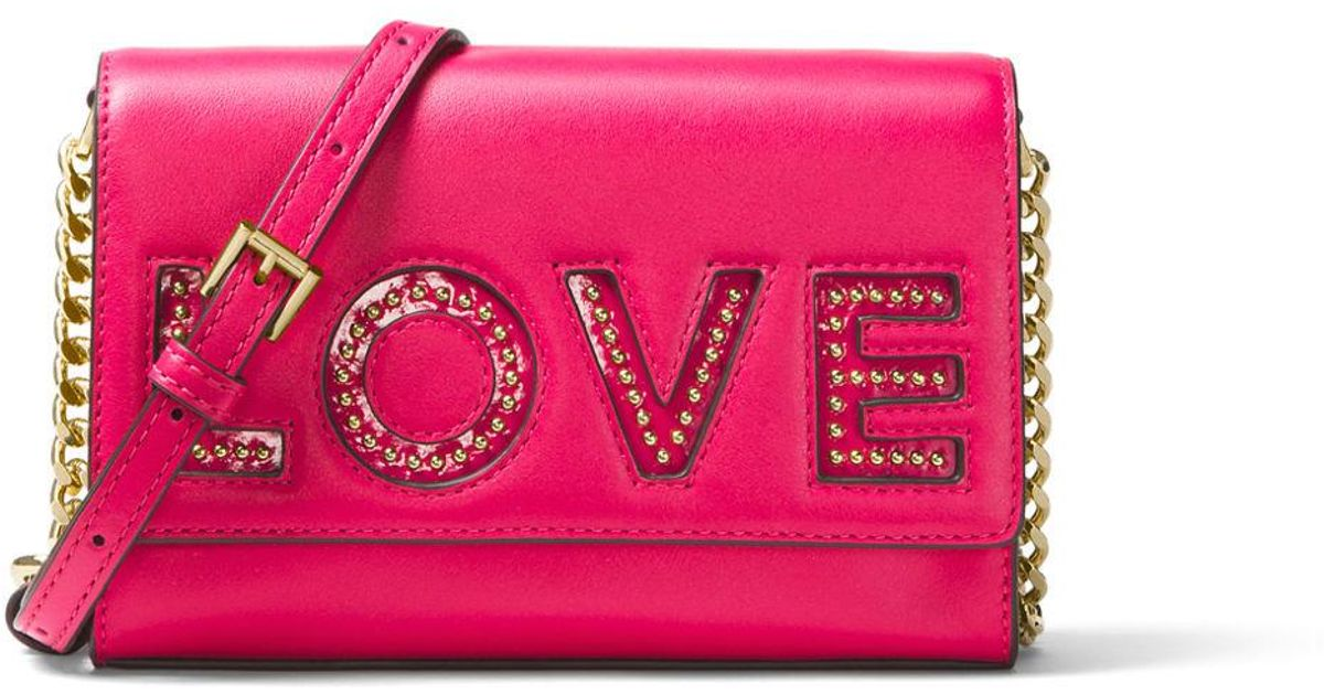 8c30f6b2f661 Lyst - MICHAEL Michael Kors Ruby Medium Love Polished Leather Clutch Bag in  Pink