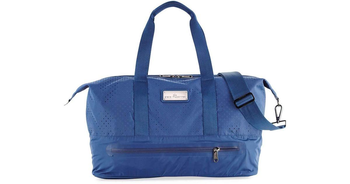 Lyst - adidas By Stella McCartney Laser-cut Mesh Modern Gym Bag in Blue e27173ac56