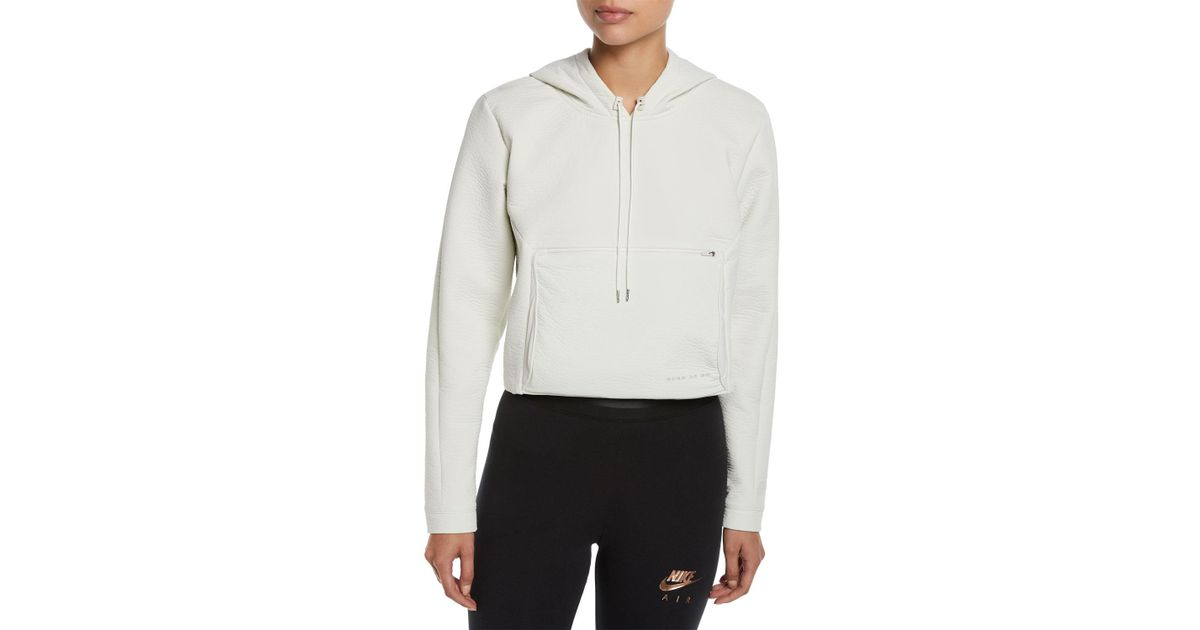 1bd95a8c564f Lyst - Nike Packable Tech Cropped Pullover Hoodie in Natural