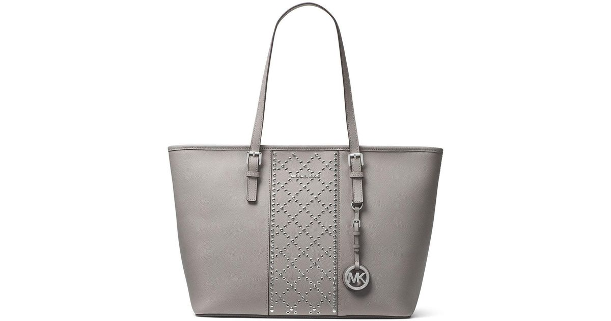 ad8445d411f85 Lyst - MICHAEL Michael Kors Jet Set Travel Studded Saffiano Tote Bag in Gray