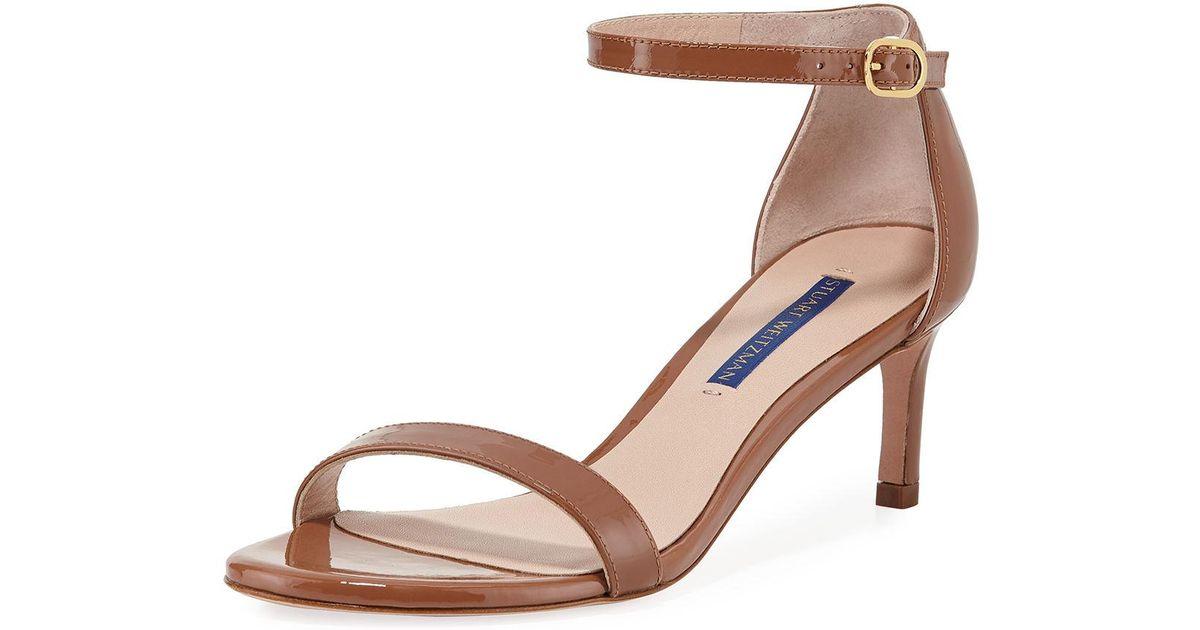 8ff4124353d3 Lyst - Stuart Weitzman Nunaked Straight Patent Leather Sandals