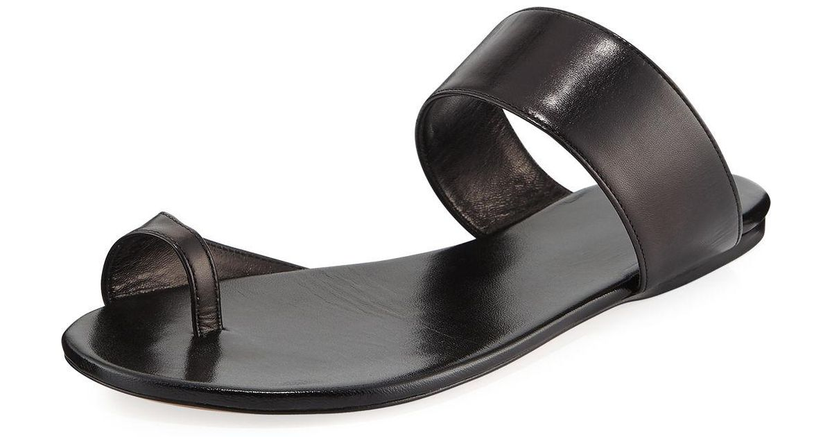 f3ab90099497 Lyst - The Row Infradito Flat Leather Toe-strap Slide Sandals in Black