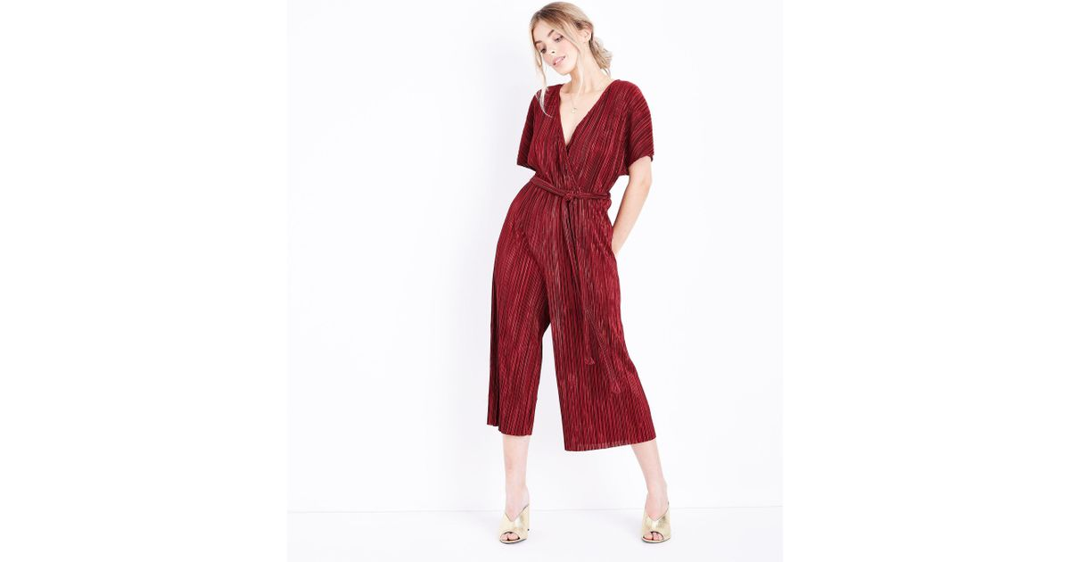 721cf48540 New Look Petite Burgundy Plisse Wrap Front Culotte Jumpsuit in Red - Lyst