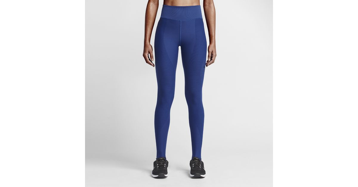 58c50ea9ef2ad Nike Zoned Sculpt Stirrup Women's Training Tights in Blue - Lyst