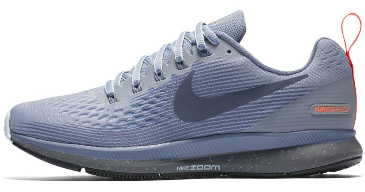 6473d949f86 Lyst - Nike Air Zoom Pegasus 34 Shield Women s Running Shoe in Blue