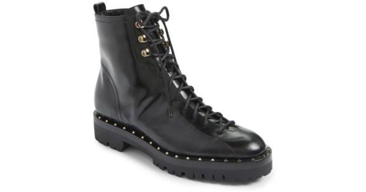 e277ac496f9 Valentino Rockstud Combat Boot in Black - Lyst