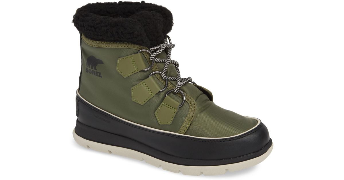 b38e2e594 Lyst - Sorel Explorer Carnival Waterproof Boot With Faux Fur Collar in  Green - Save 20%