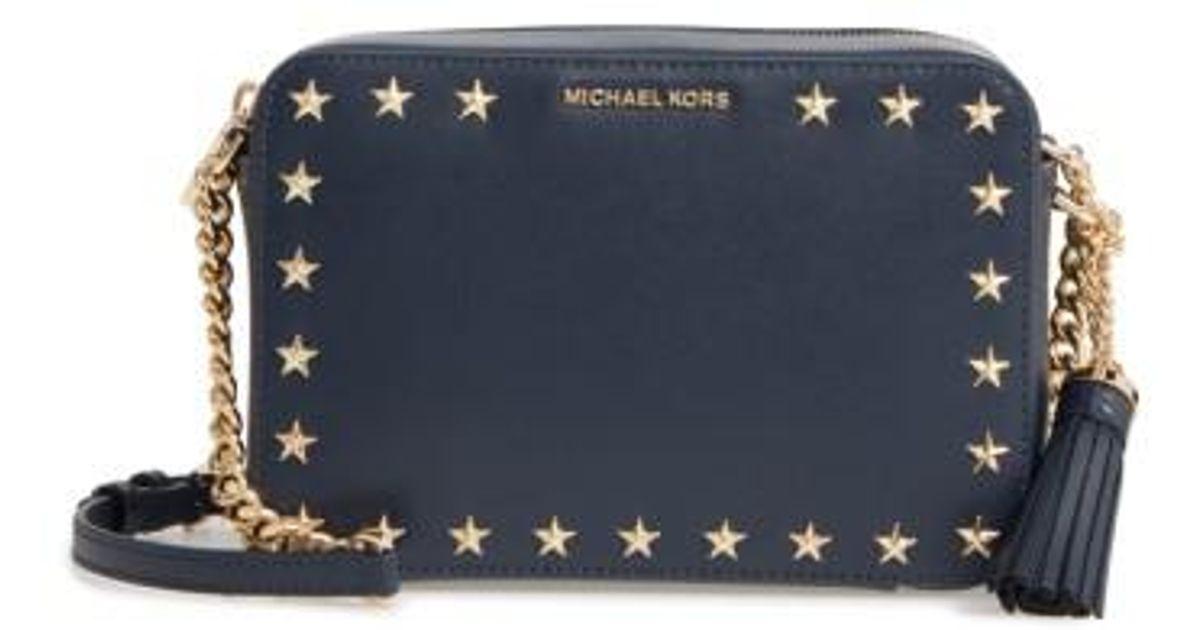 d4c48c4a88ff Lyst - MICHAEL Michael Kors Medium Ginny Star Studded Leather Crossbody  Camera Bag in Blue