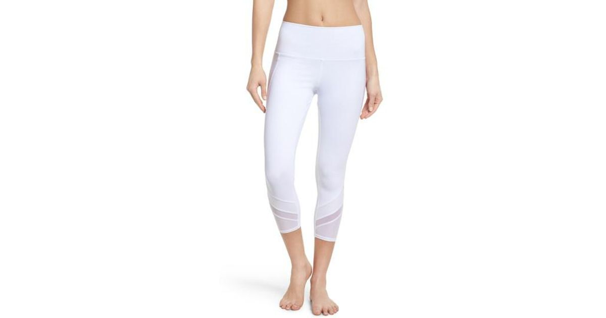 5057712ed7f75c Lyst - Alo Yoga Elevate High Waist Capri Leggings in White